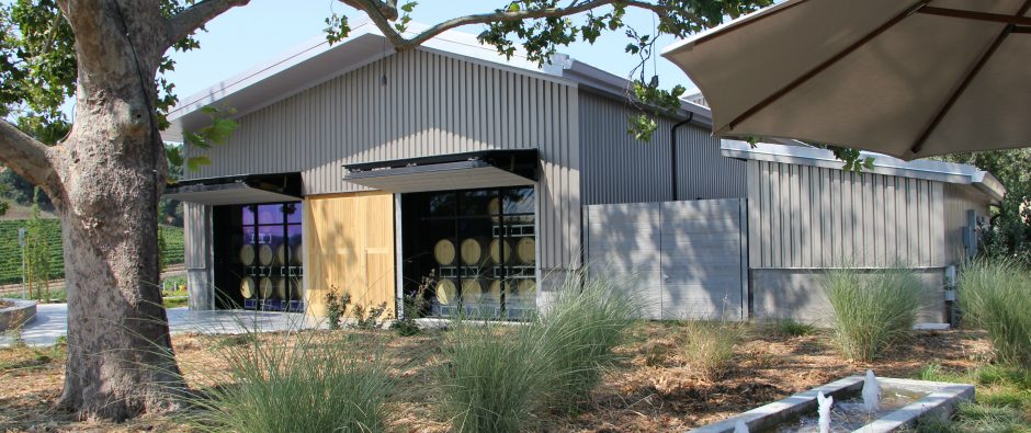 Picture of a winery barrel building.